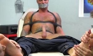 Bound hunk cocksucked and foot licked in BDSM