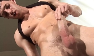 Ripped euro stud tugging on tall dong