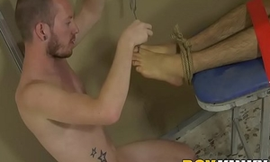 Deviant homo uses bound twink feet for cock stroking