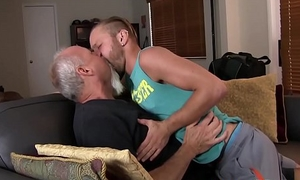 Inked twink receives a big mature boner up the rear