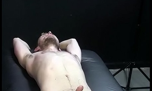 Inked hunk punishes deviant feet and body with tingling