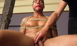 Gagged hunk gets bound and edged by maledom