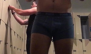 Amateur changing at the gym locker room (after shower)