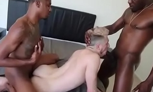 the boy with two black guys